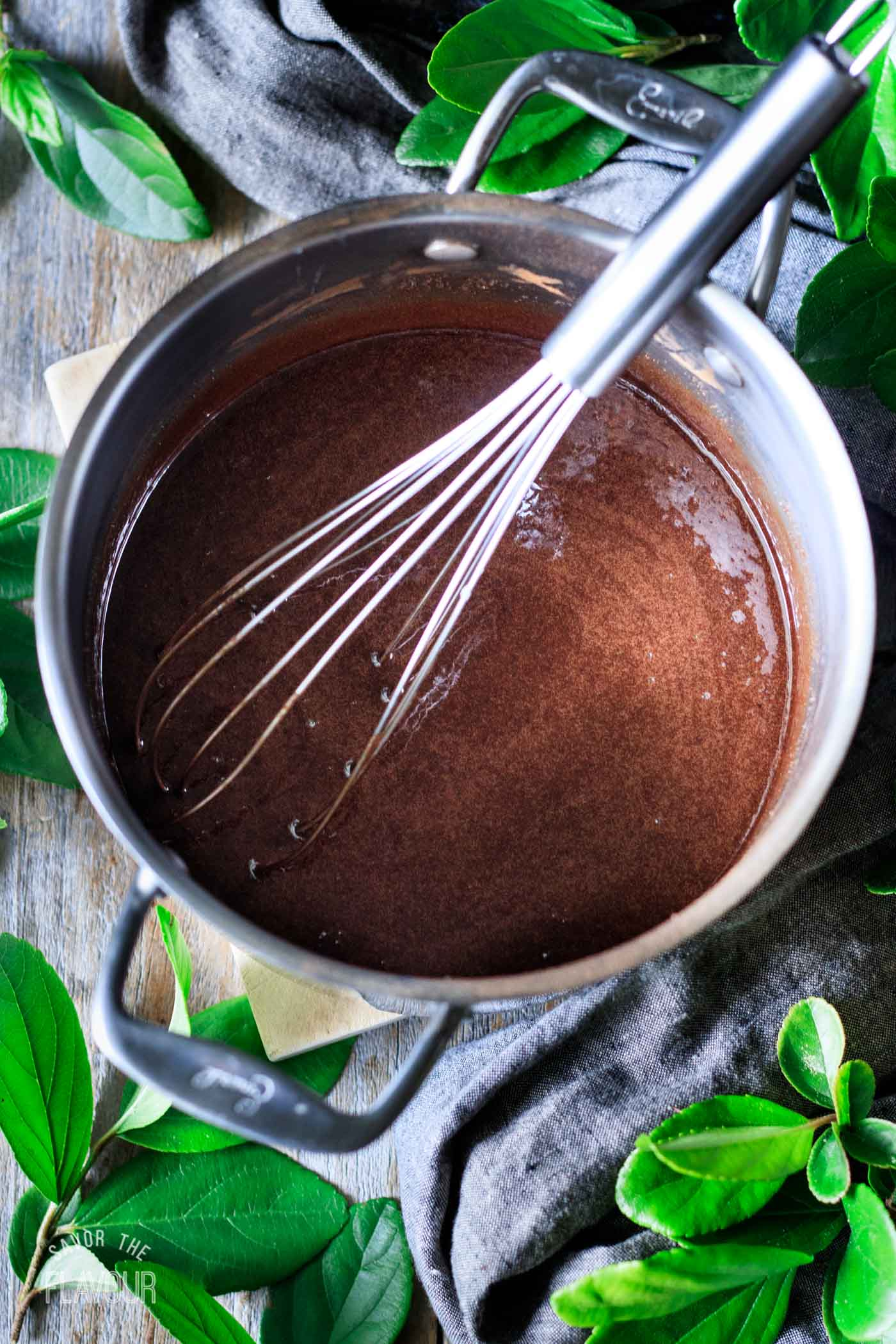 whisking the fudge mixture in a saucepan