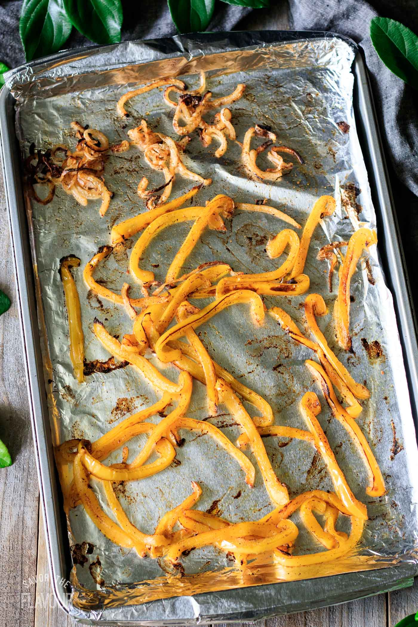 roasted bell peppers and onions on a tray
