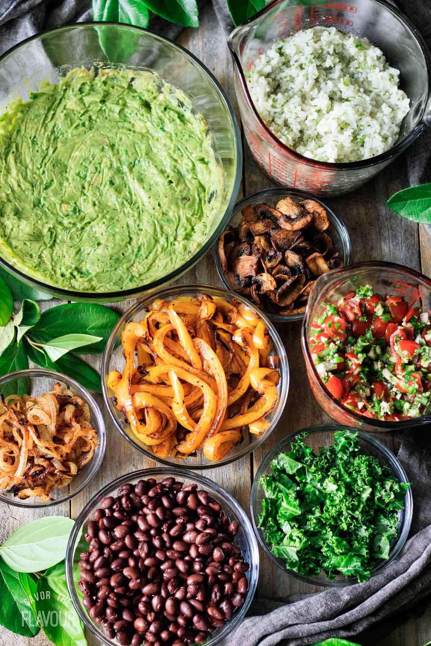 bowls of ingredients for vegan burrito bowl