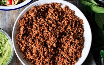 large bowl of walnut meat with tacos and toppings