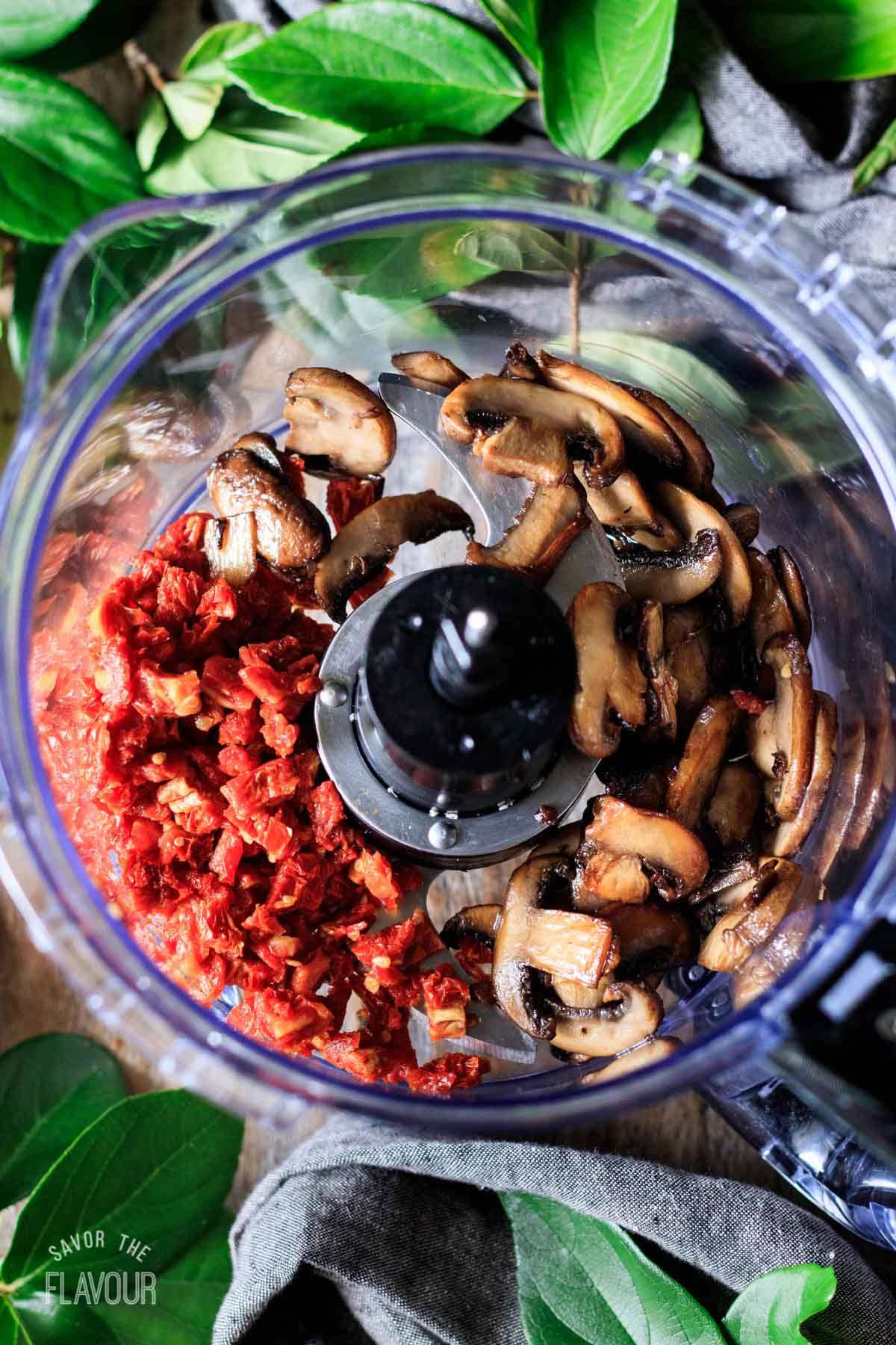 sun dried tomatoes and sauteed mushrooms in a food processor