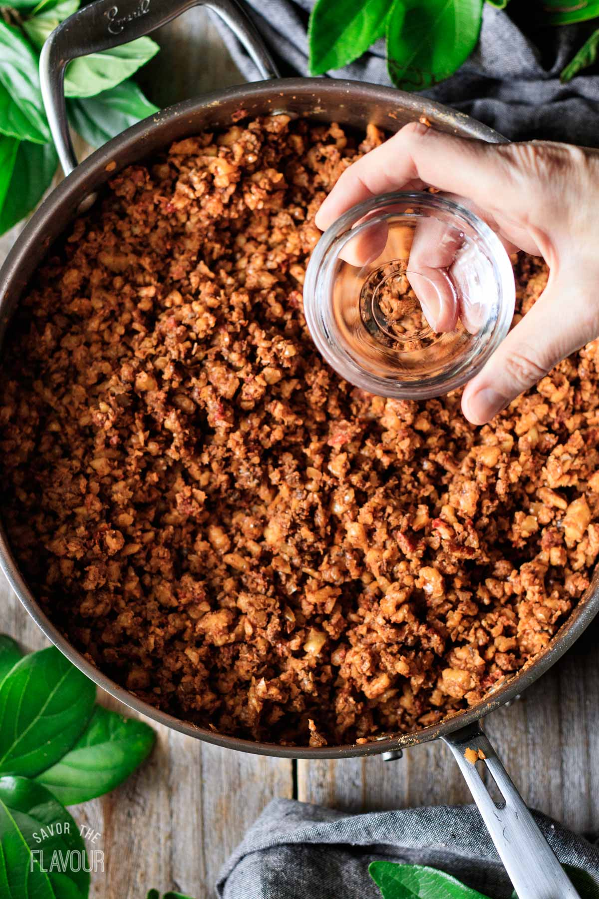 adding water to pan of walnut taco meat