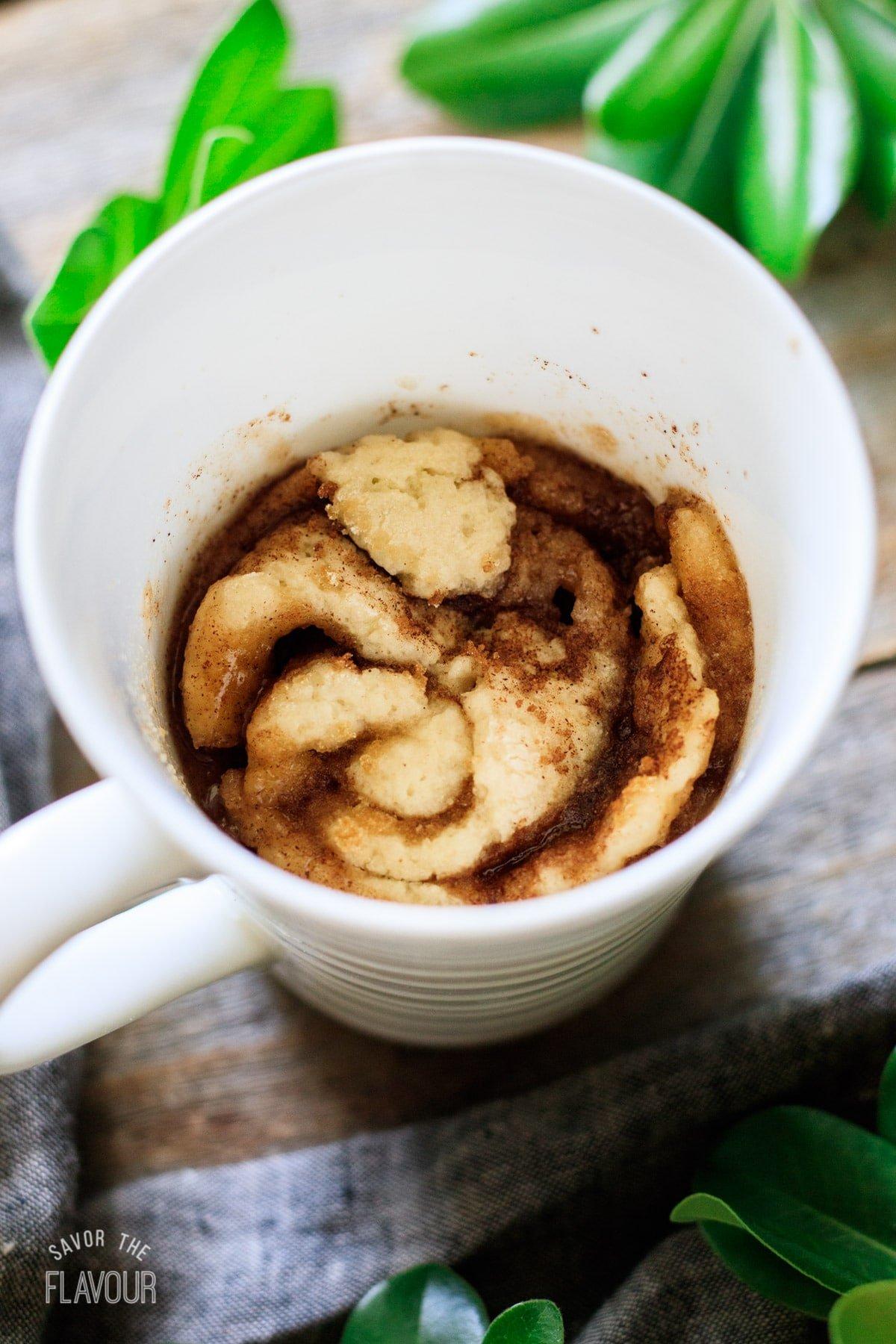 baked cinnamon roll in a mug