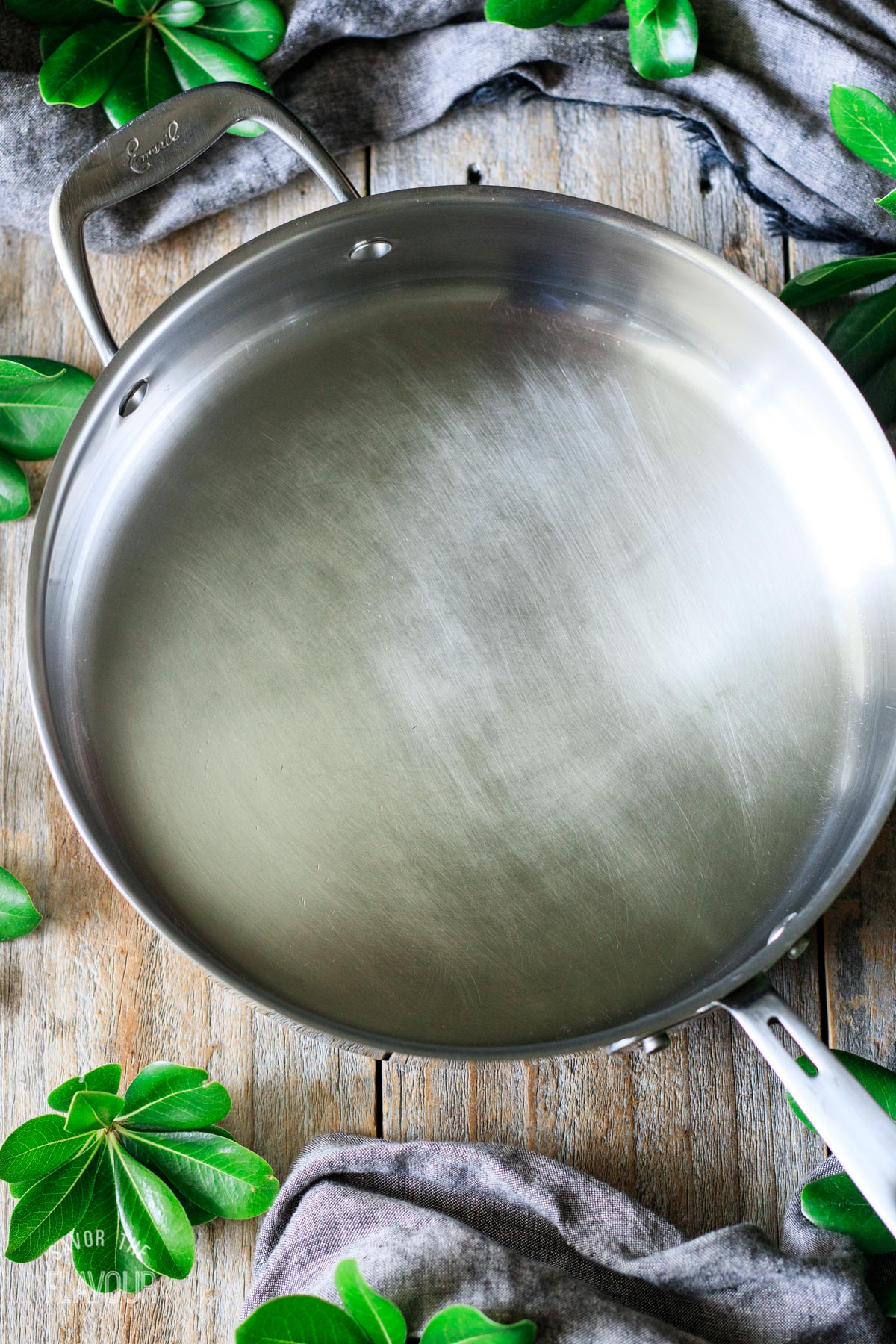 an empty stainless steel skillet