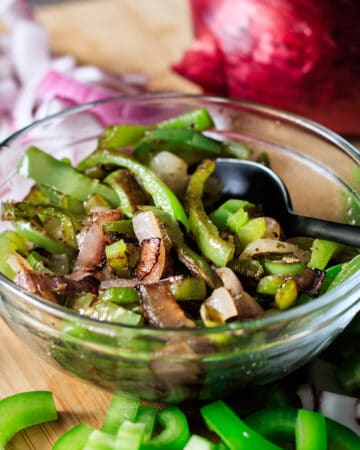 bowl of fajita veggies with fresh peppers and onions