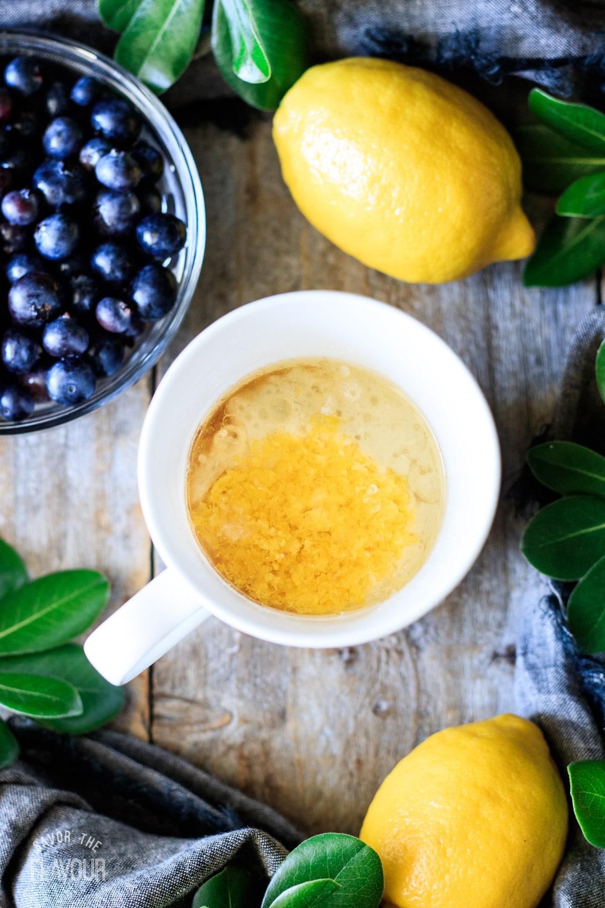 adding lemon zest, milk, lemon juice, and oil to flour mixture
