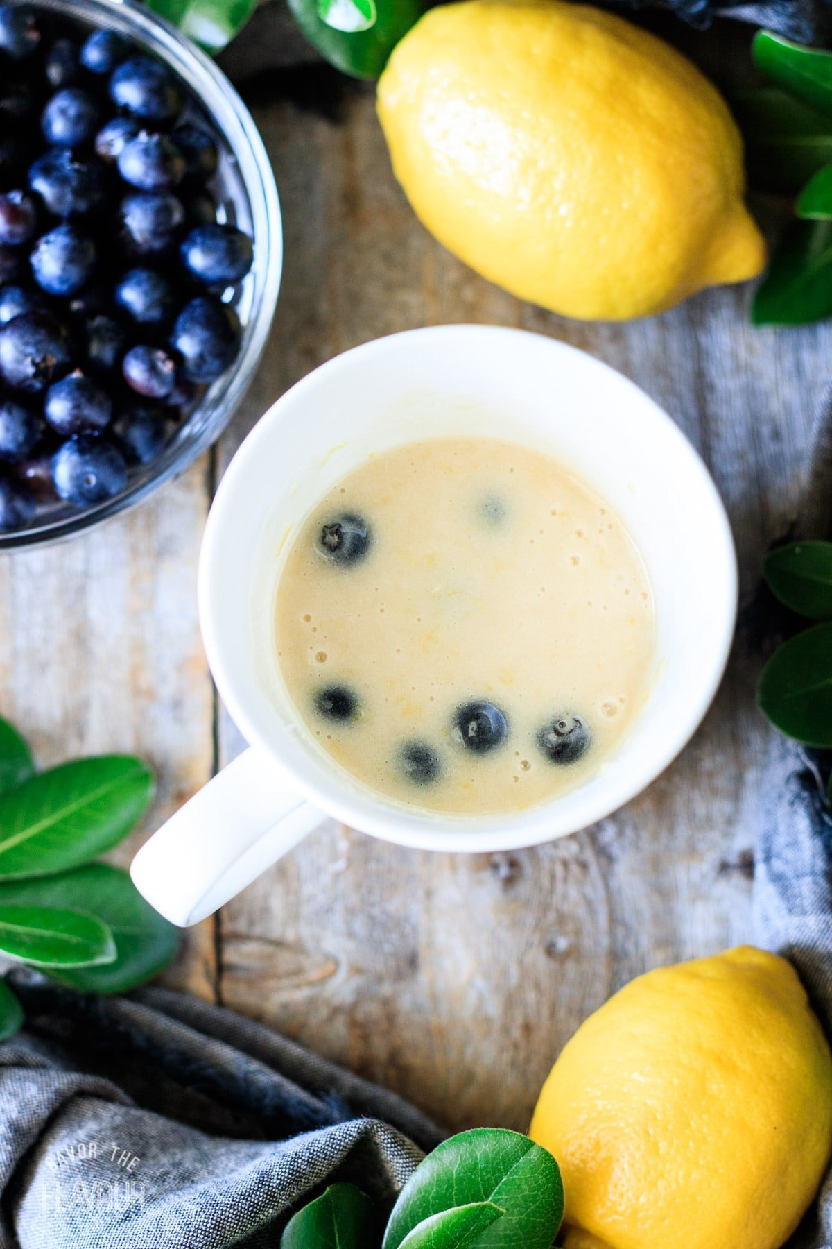 cake batter with lemon zest and blueberries mixed in