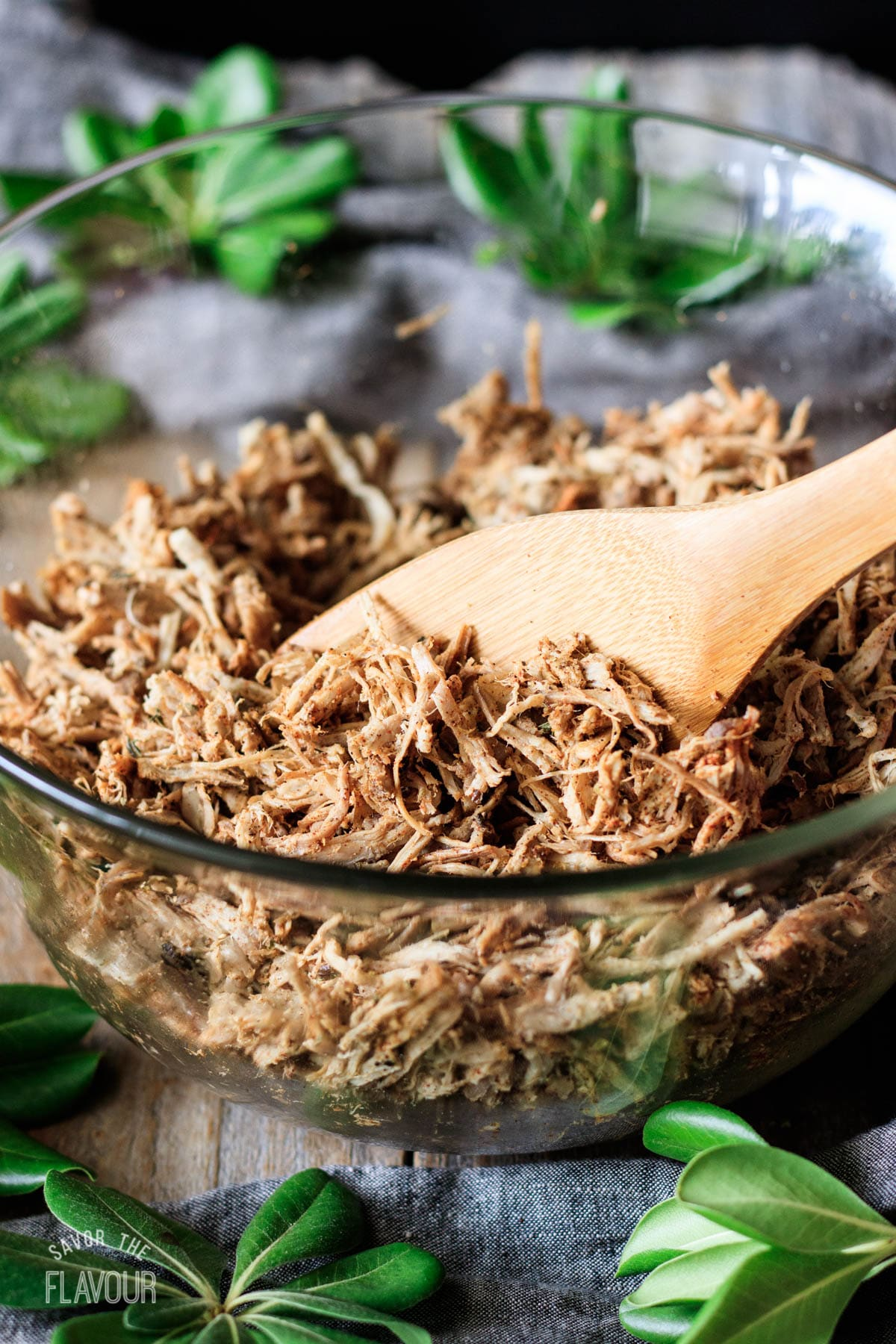 tossing the shredded pork with spices