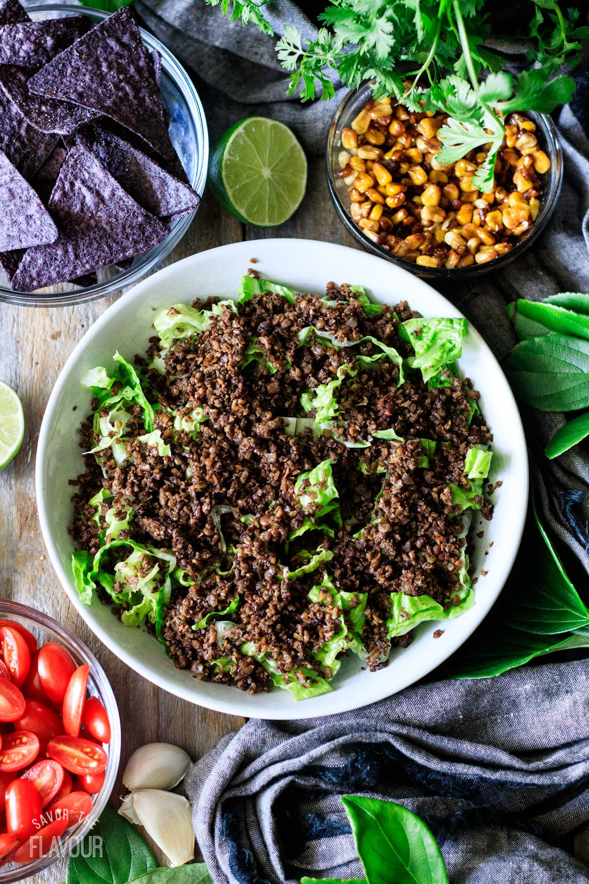 putting the cauliflower pepita taco meat on top of the lettuce