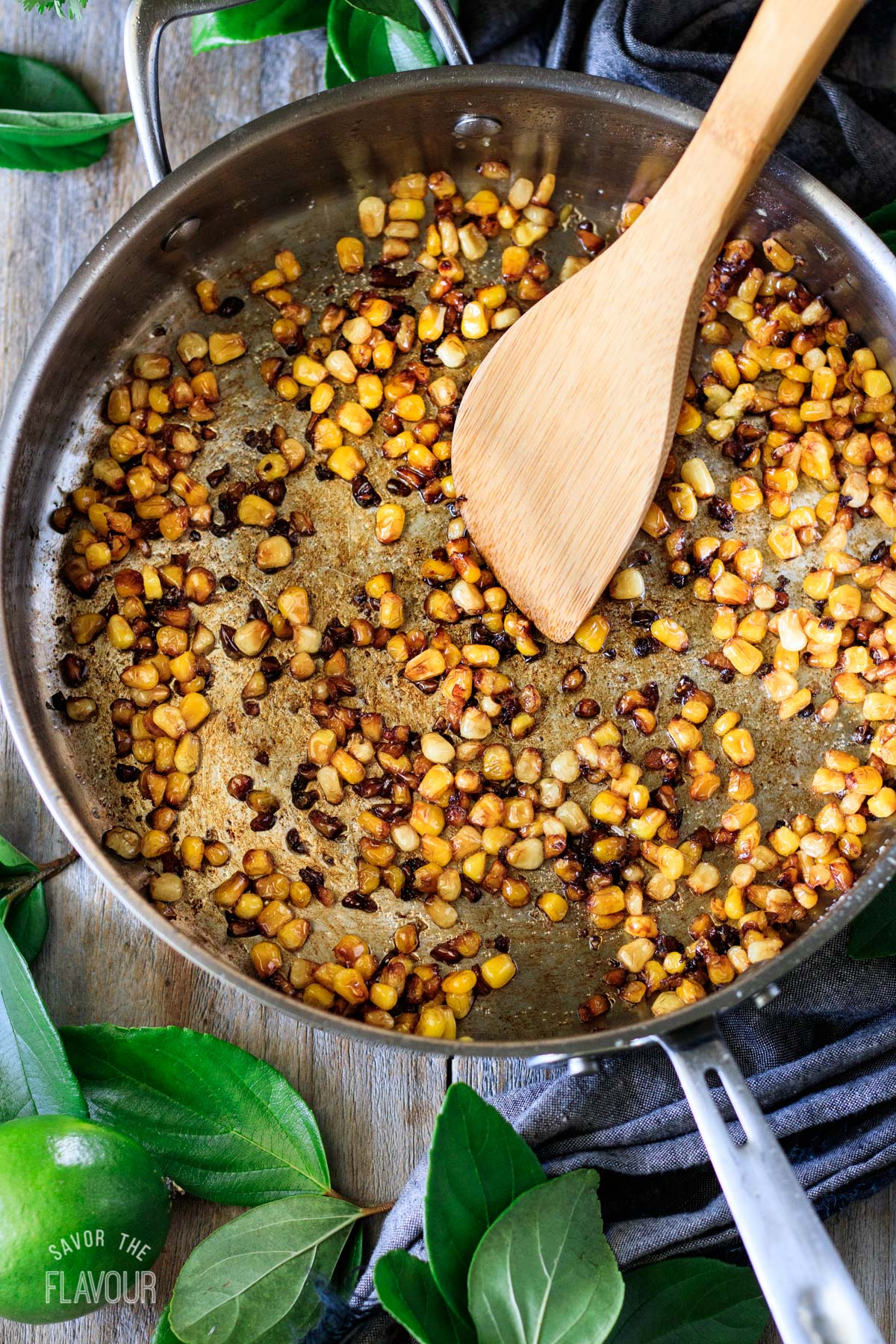 cooked corn kernels in a skillet