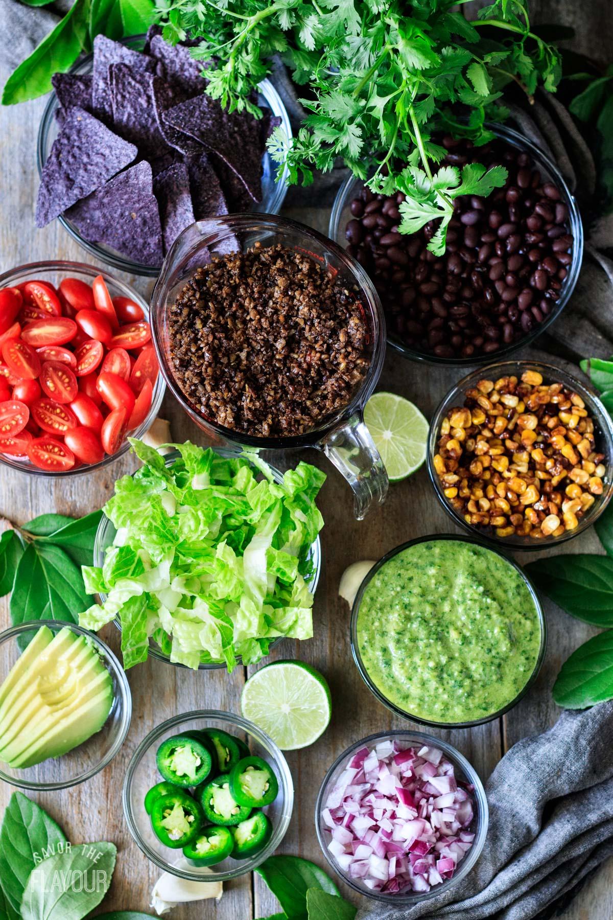 bowls of ingredients for vegan taco salad