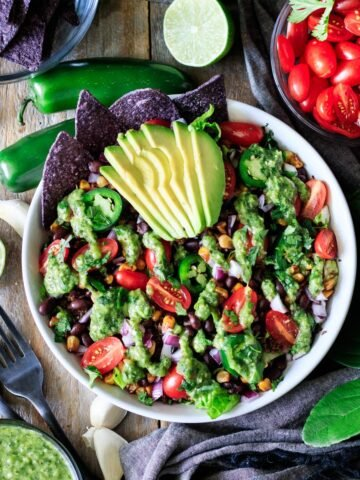 vegan taco salad with bowls of toppings