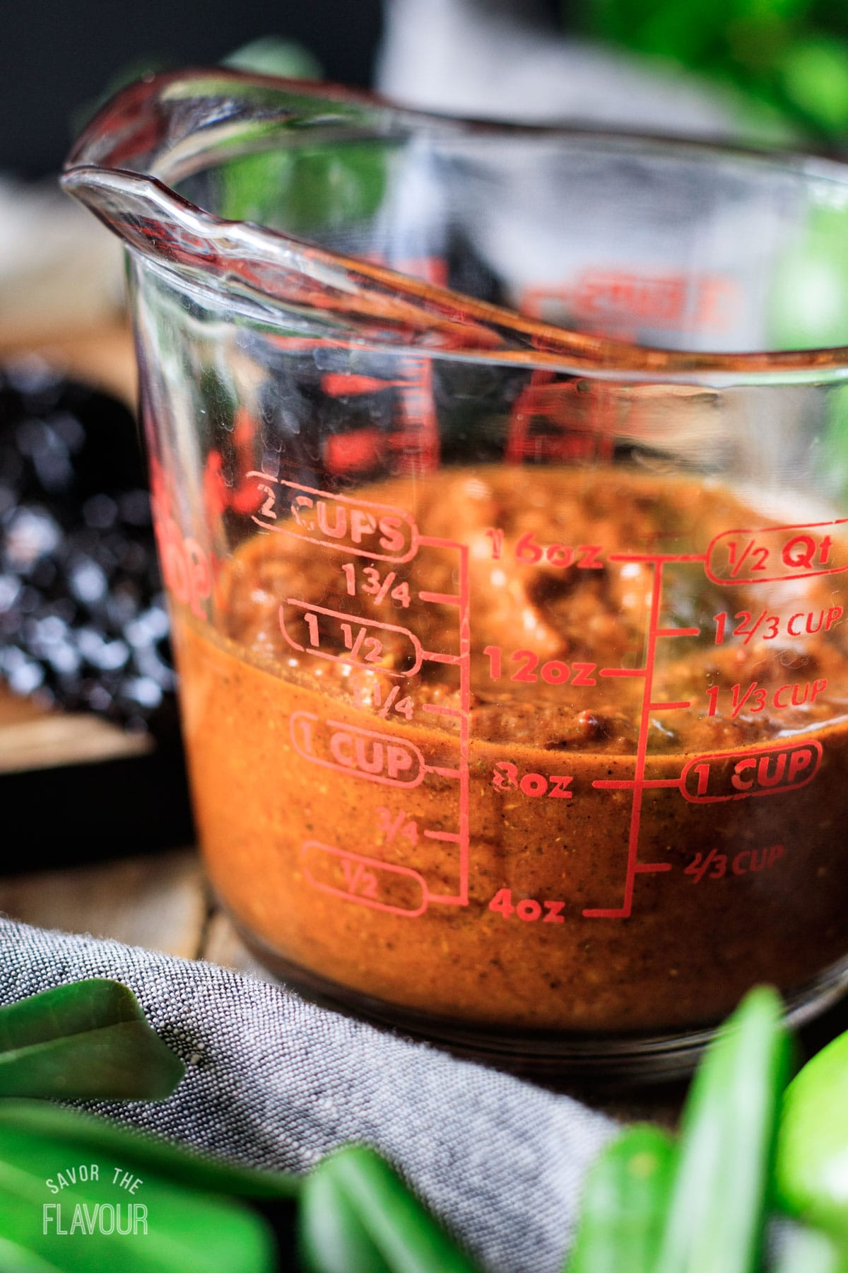 measuring the Chipotle steak marinade in a glass measuring cup