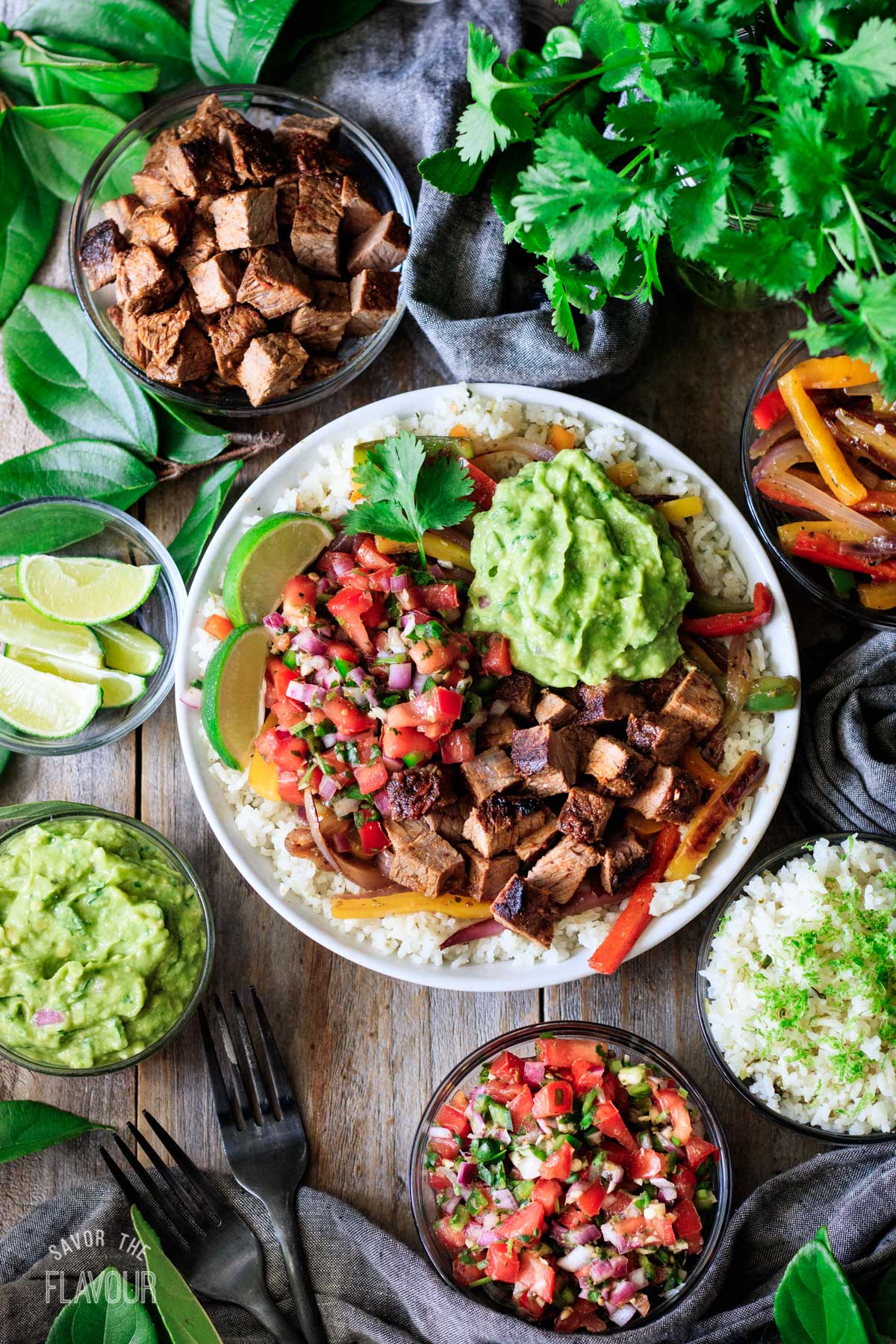 Chipotle steak in a bowl with rice, pico de gallo, and guac