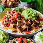 closeup of Chipotle steak with pico de gallo, rice, and guac