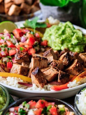 closeup of Chipotle steak with pico de gallo, rice, and guac