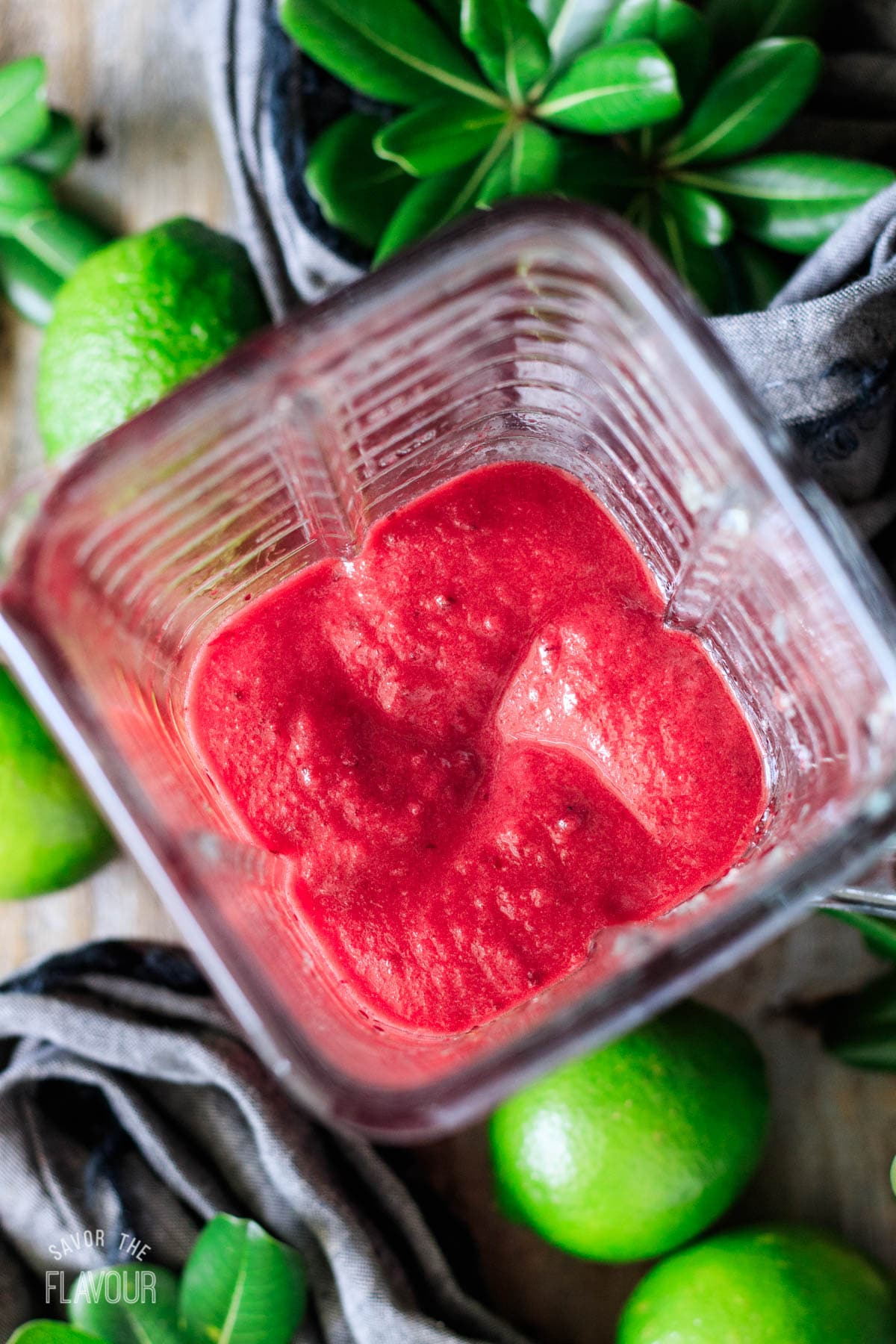 pureeing the cherries and frozen lime concentrate in a blender