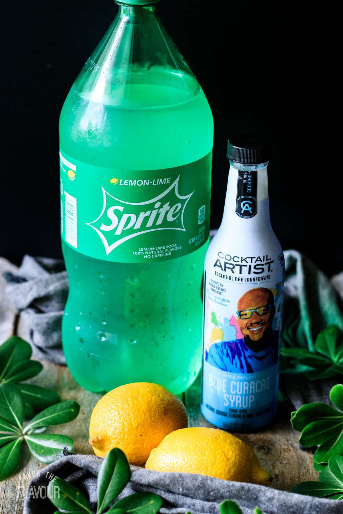 Sprite, blue Curacao syrup, and fresh lemons