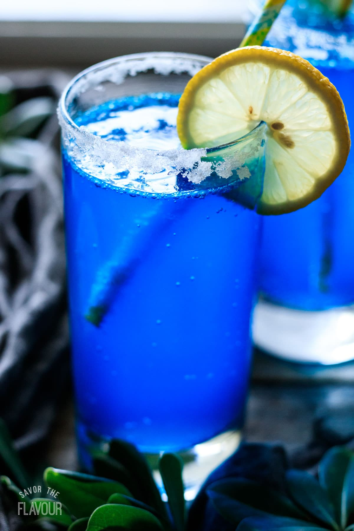 glass of blue lagoon mocktail