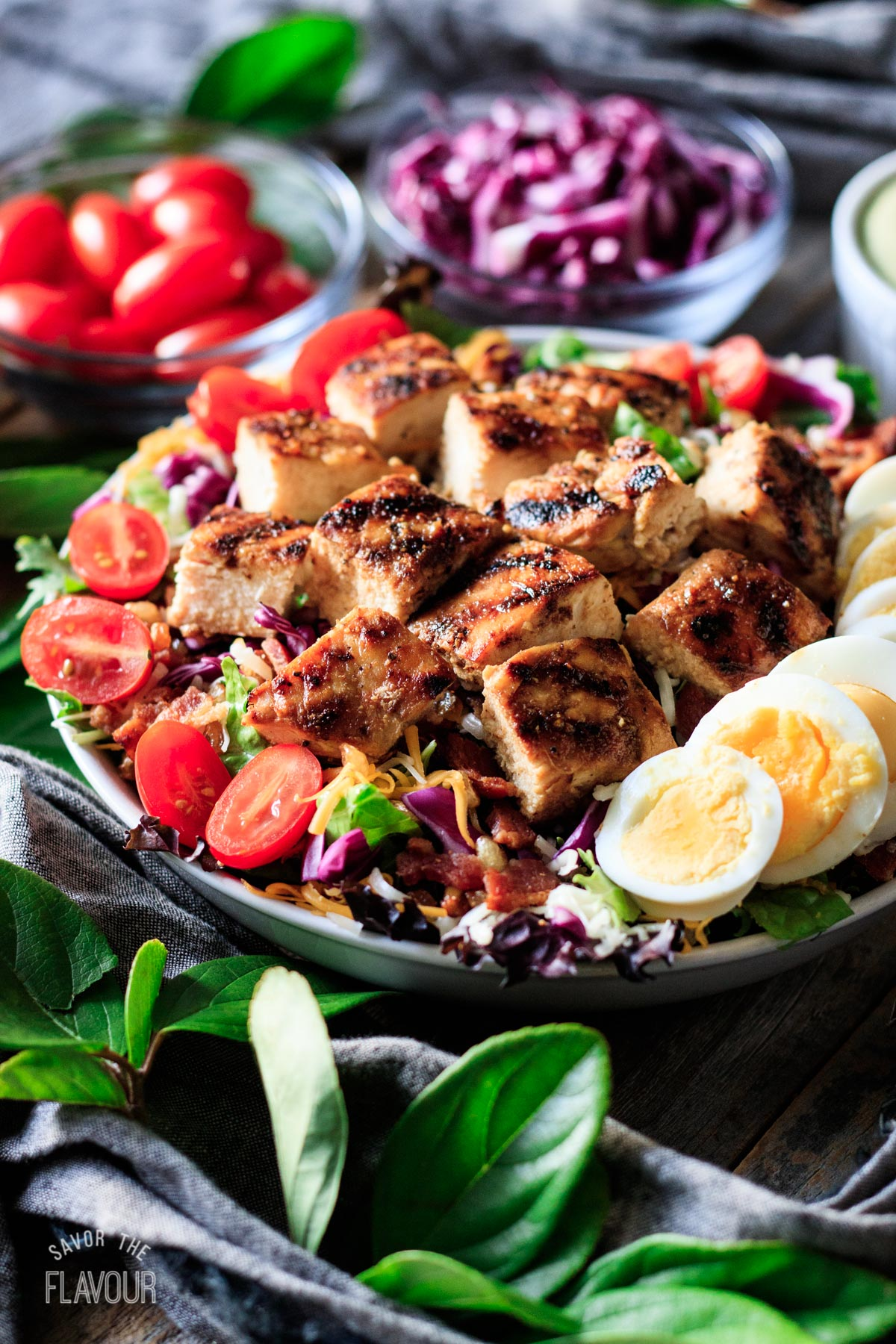 Chick-fil-A Cobb salad with bowls of toppings