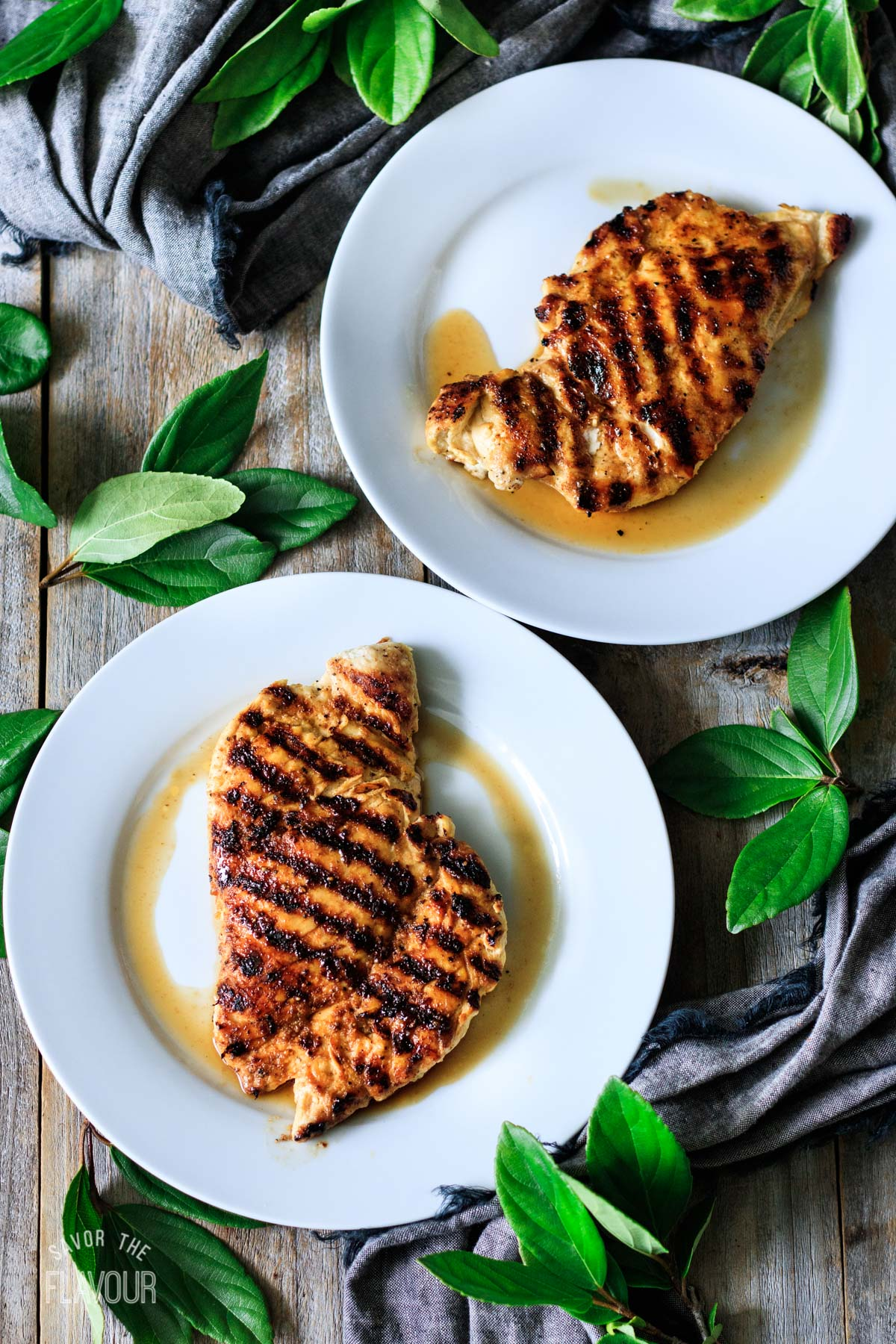 grilled chicken breasts on white plates