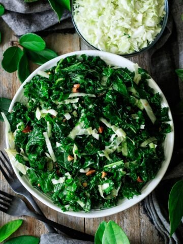 bowl of kale crunch salad with two forks