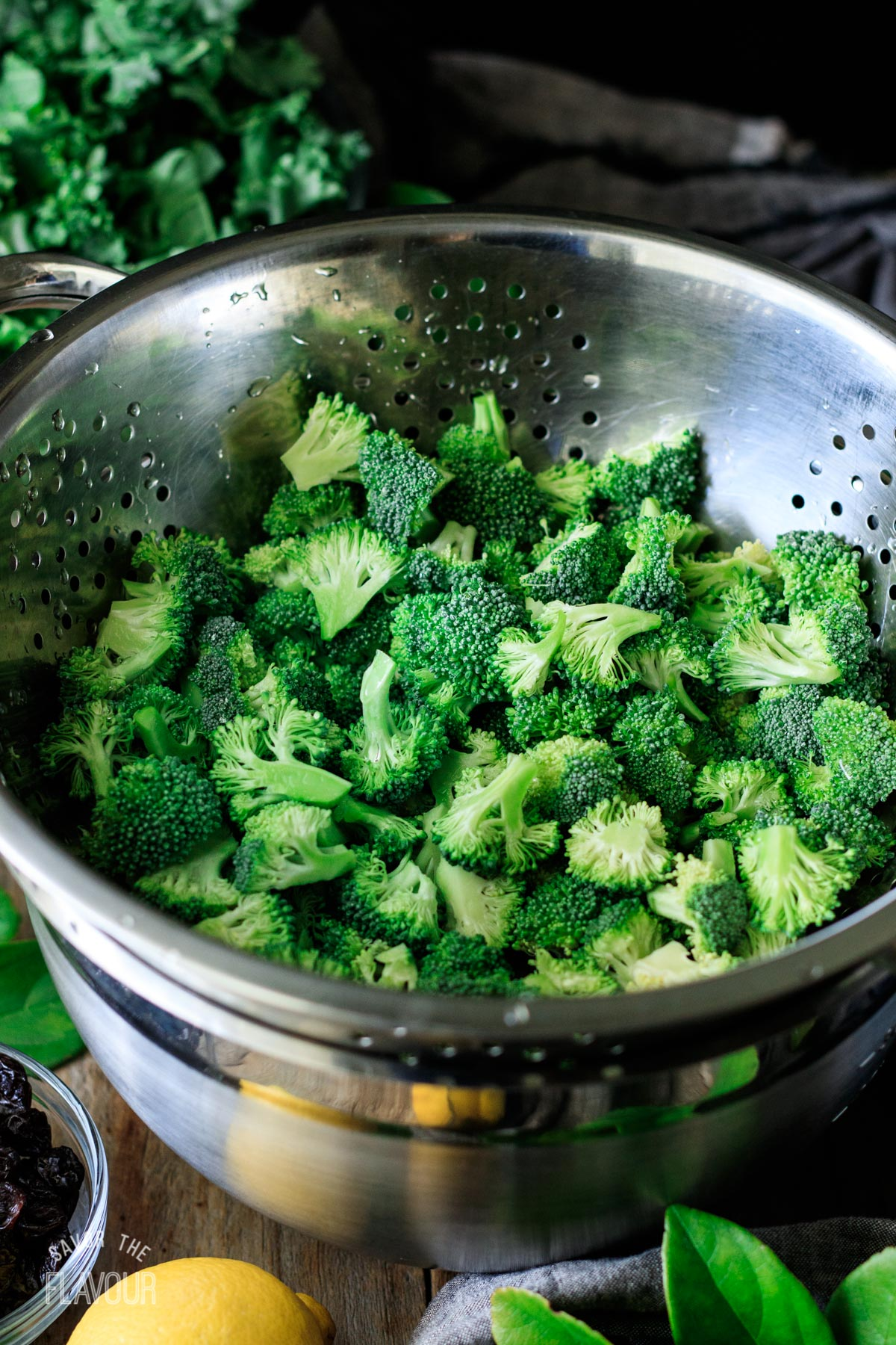 rinsed broccoli florets in a stainless steel colander