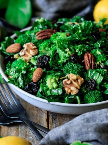 bowl of superfood salad with two forks