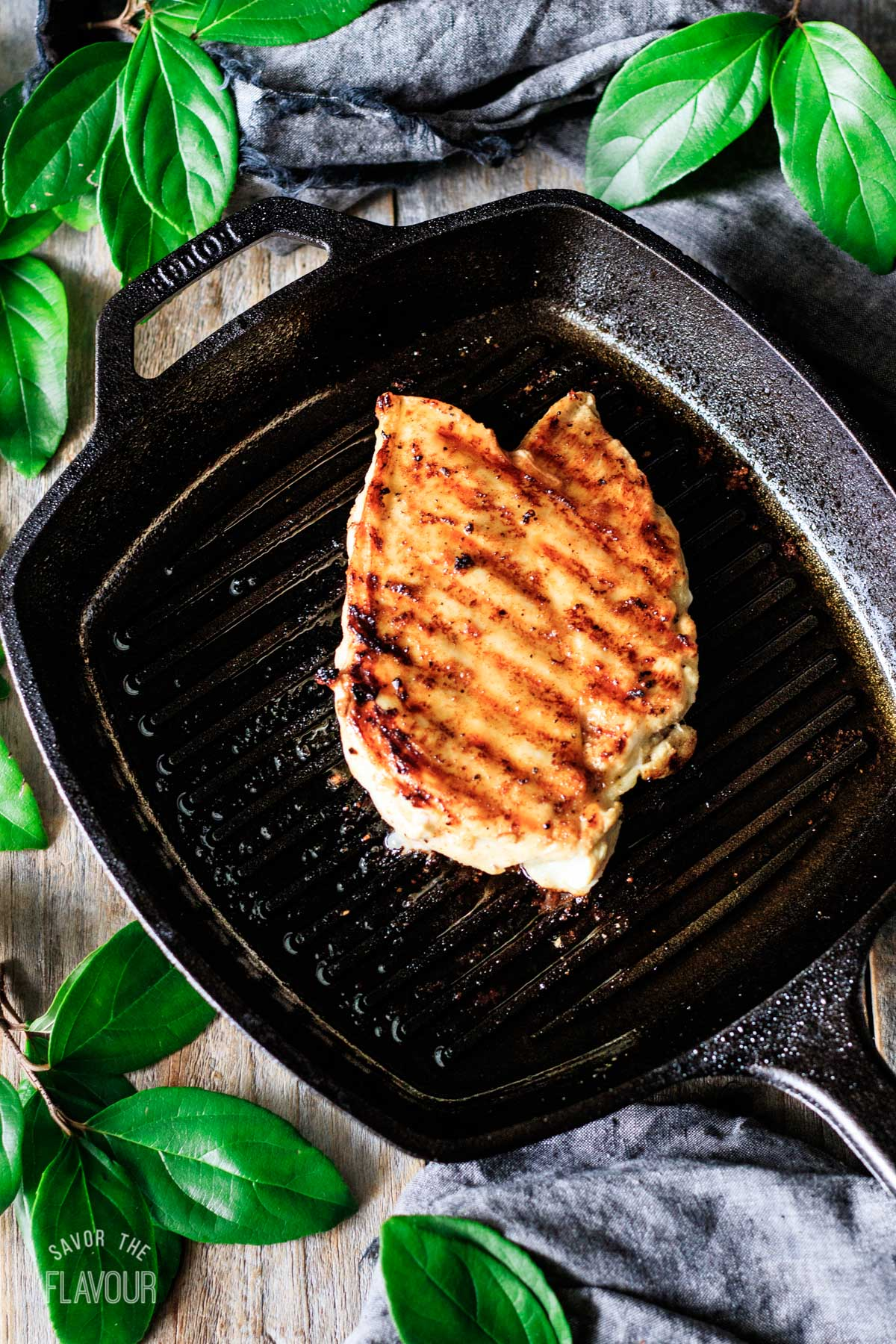grilled chicken breast in a cast iron skillet