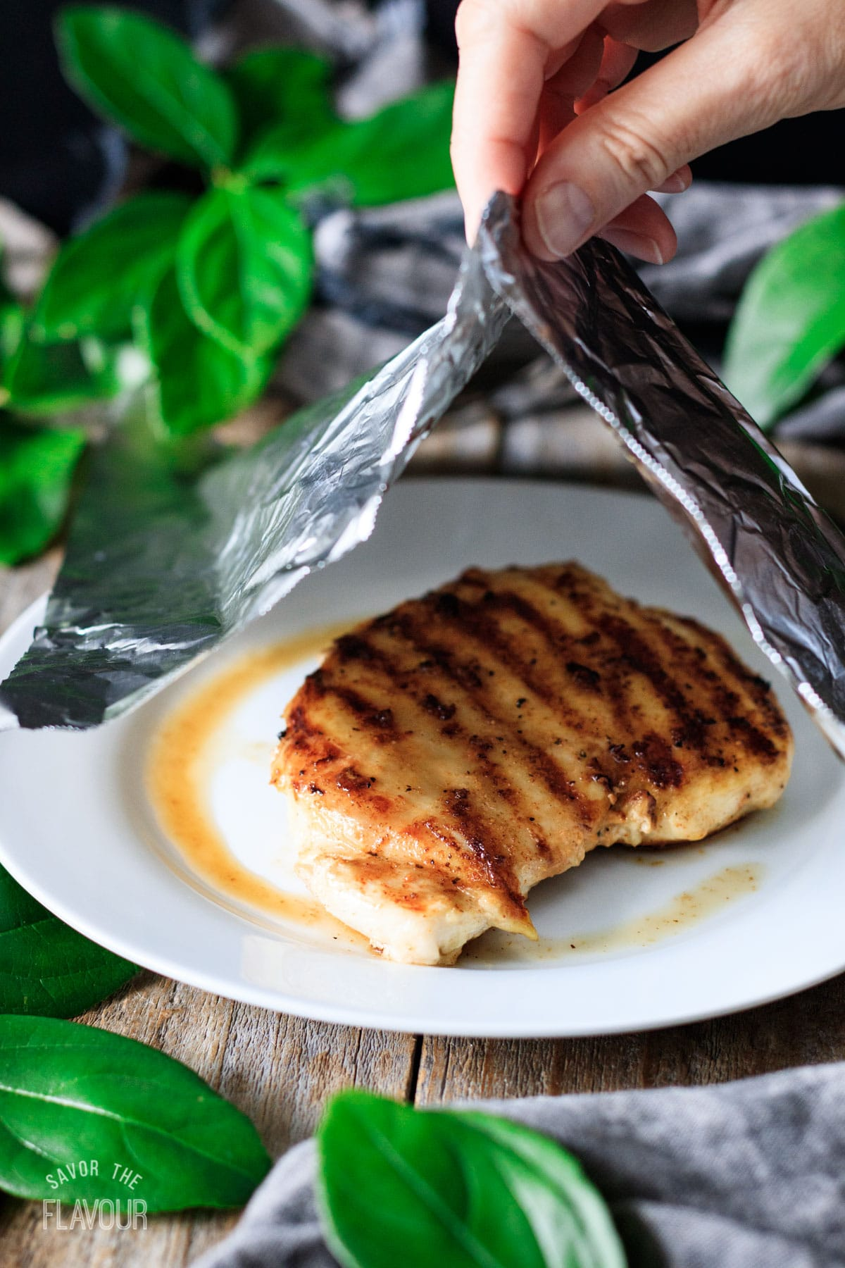 tenting a grilled chicken breast with foil