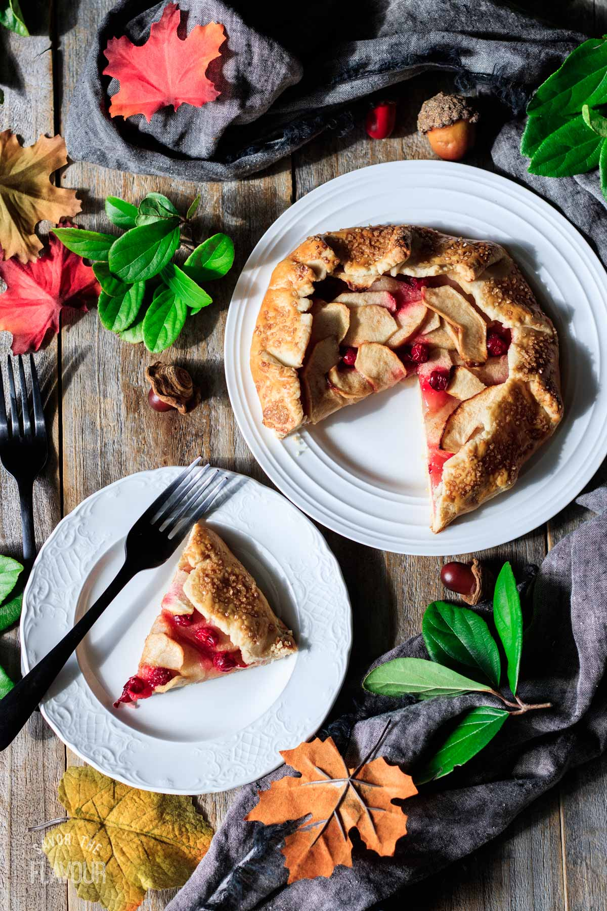 slice of cranberry apple galette on a plate with a fork
