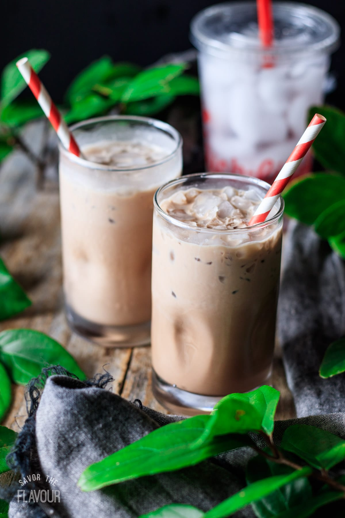 two glasses of mocha cream cold brew with paper straws