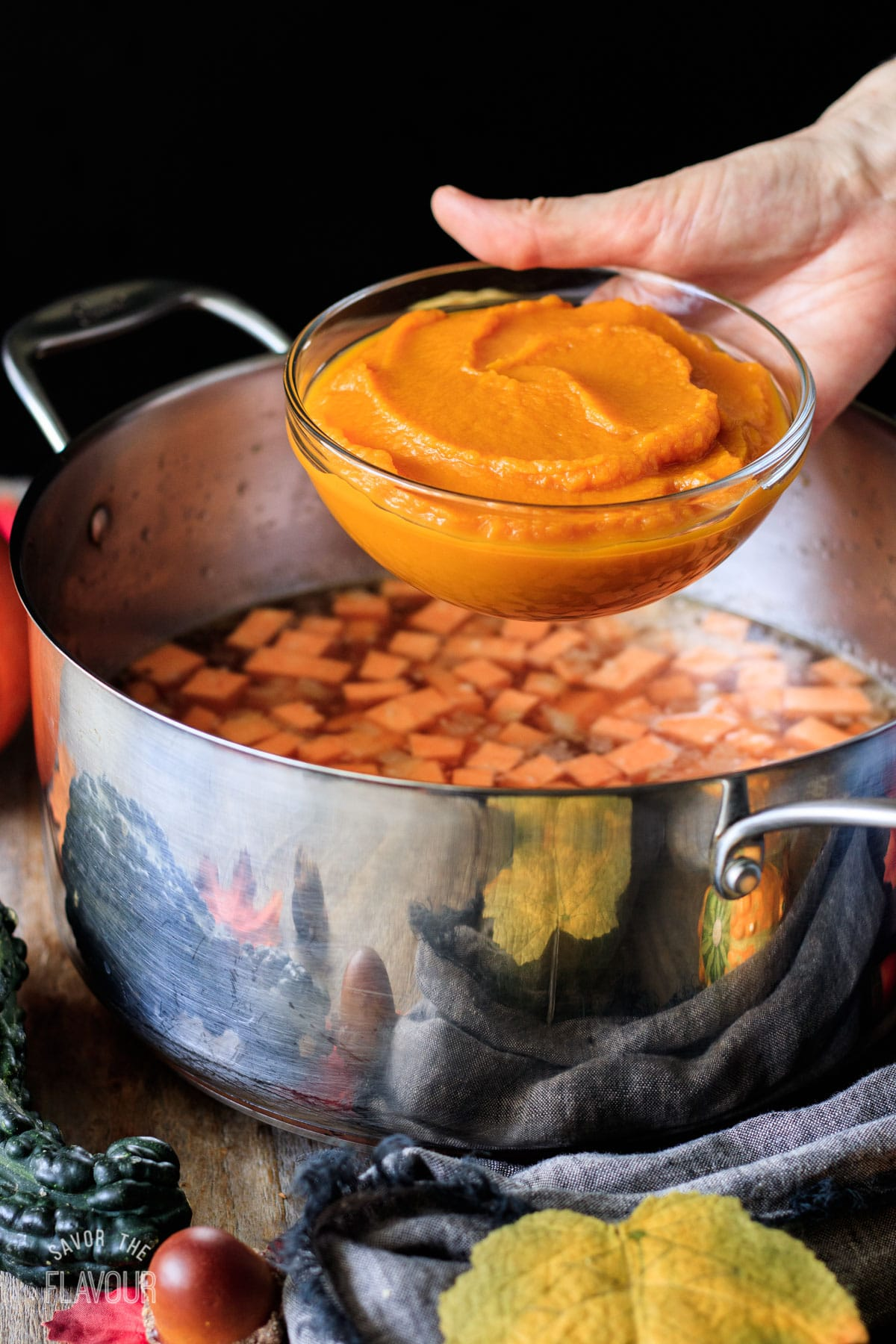 person holding a bowl of pumpkin puree
