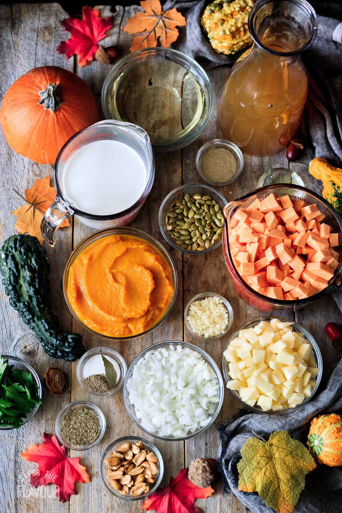 bowls of ingredients for pumpkin sweet potato soup