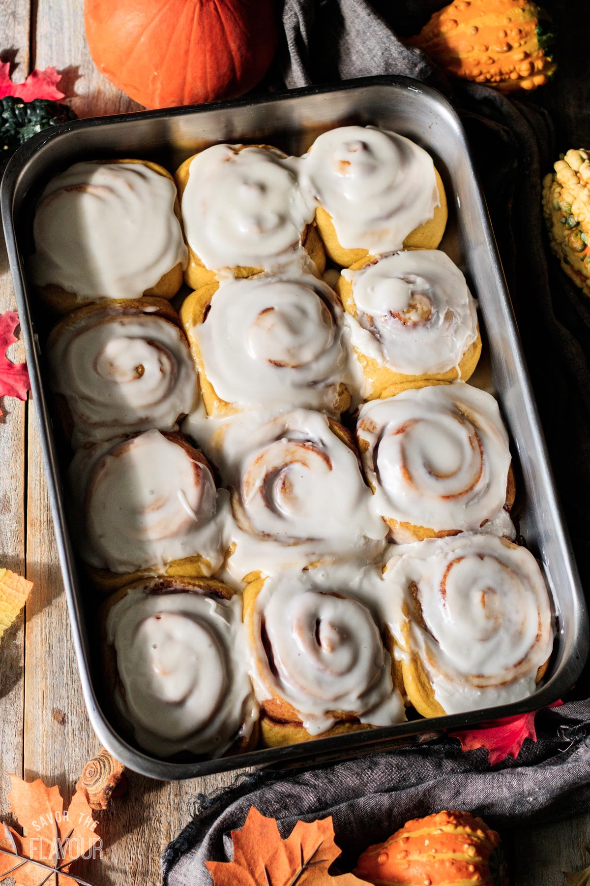 baked vegan pumpkin cinnamon rolls with frosting