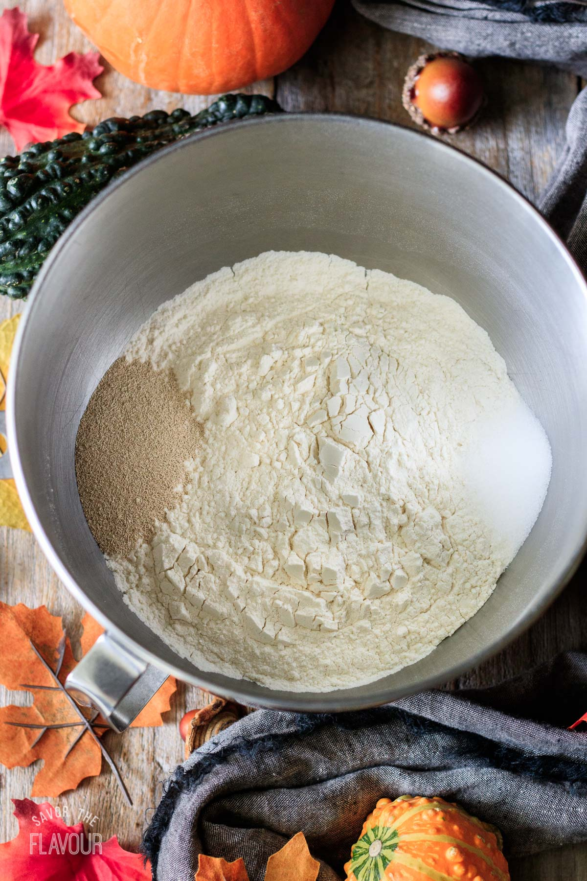 mixing bowl of flour with salt and yeast