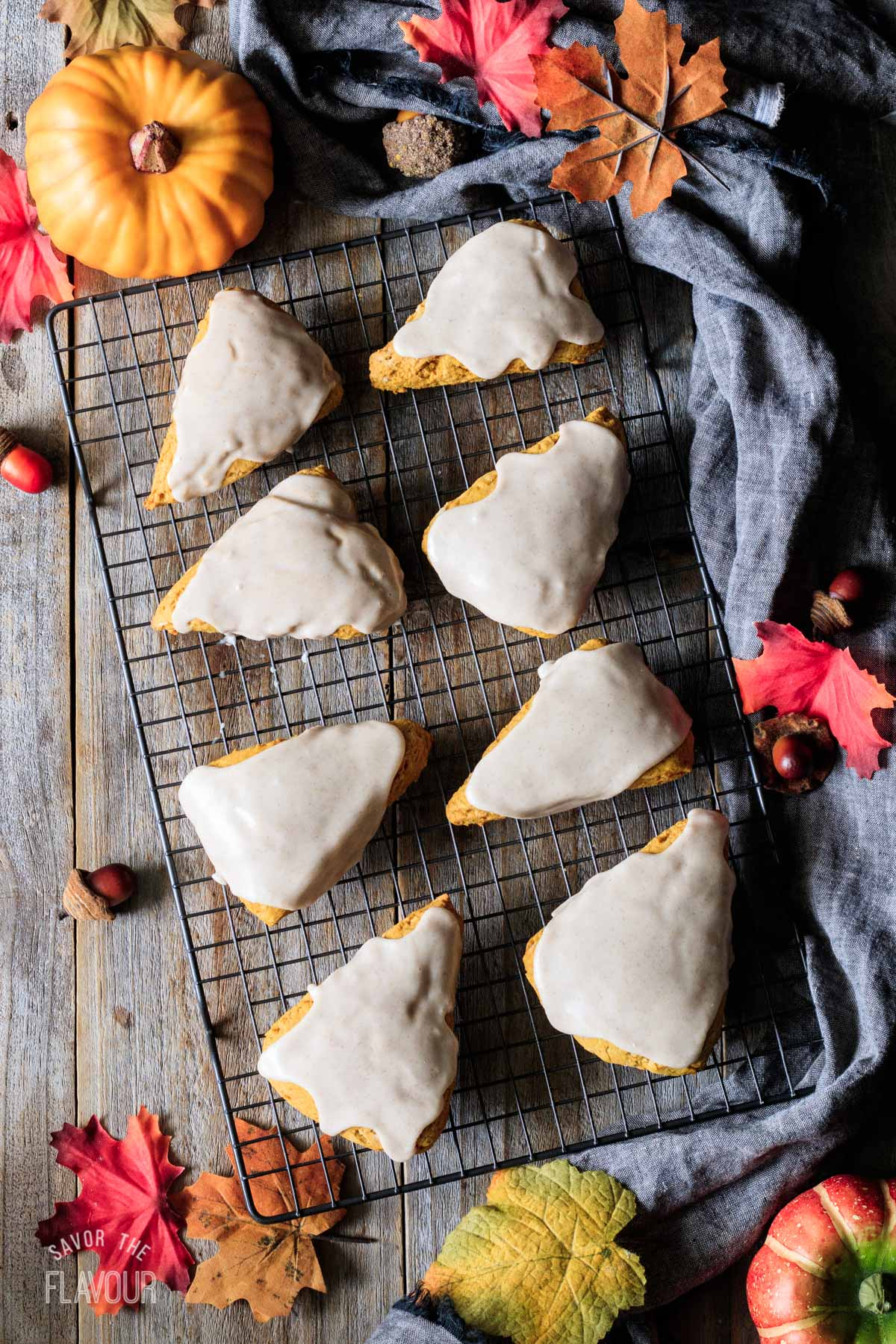 glazed pumpkin scones on a wire cooling rack