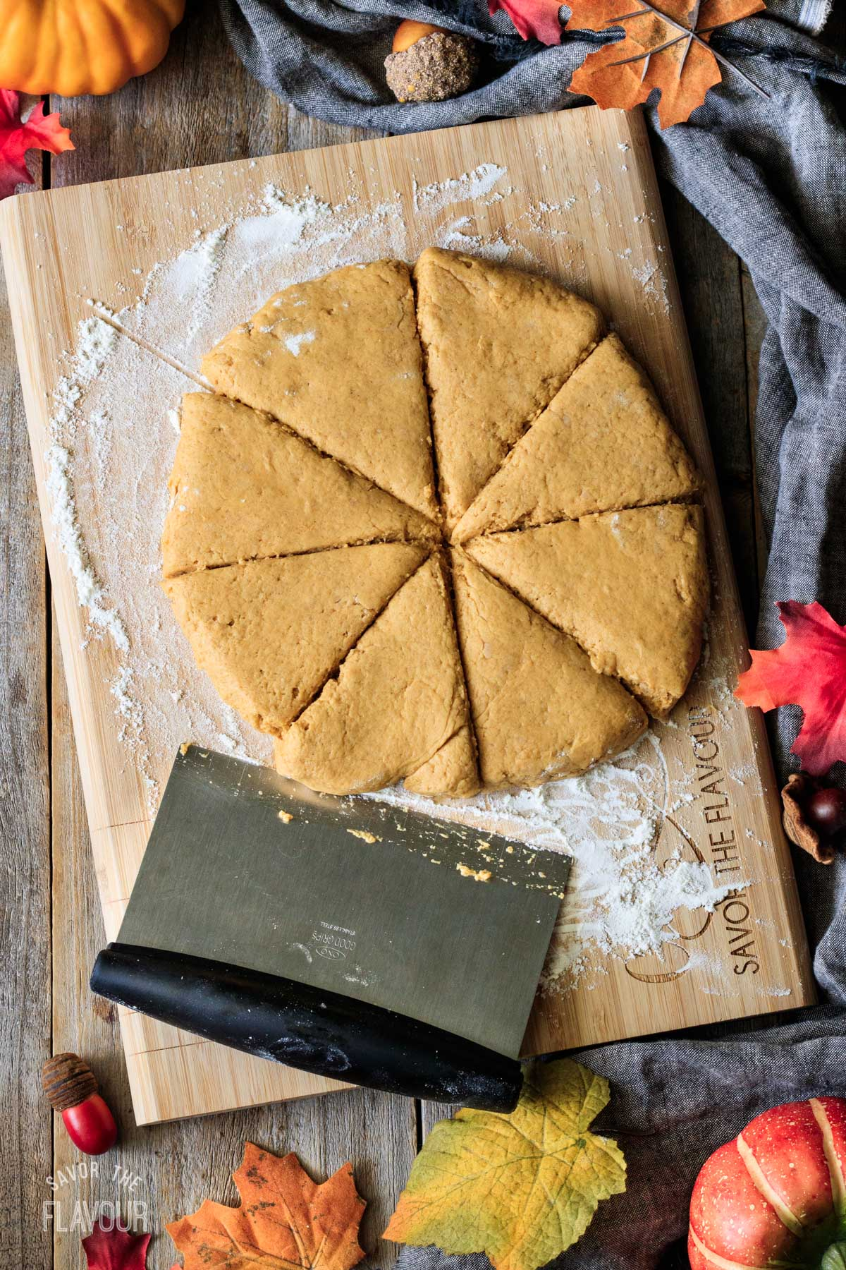 cutting pumpkin scone dough into 8 triangles