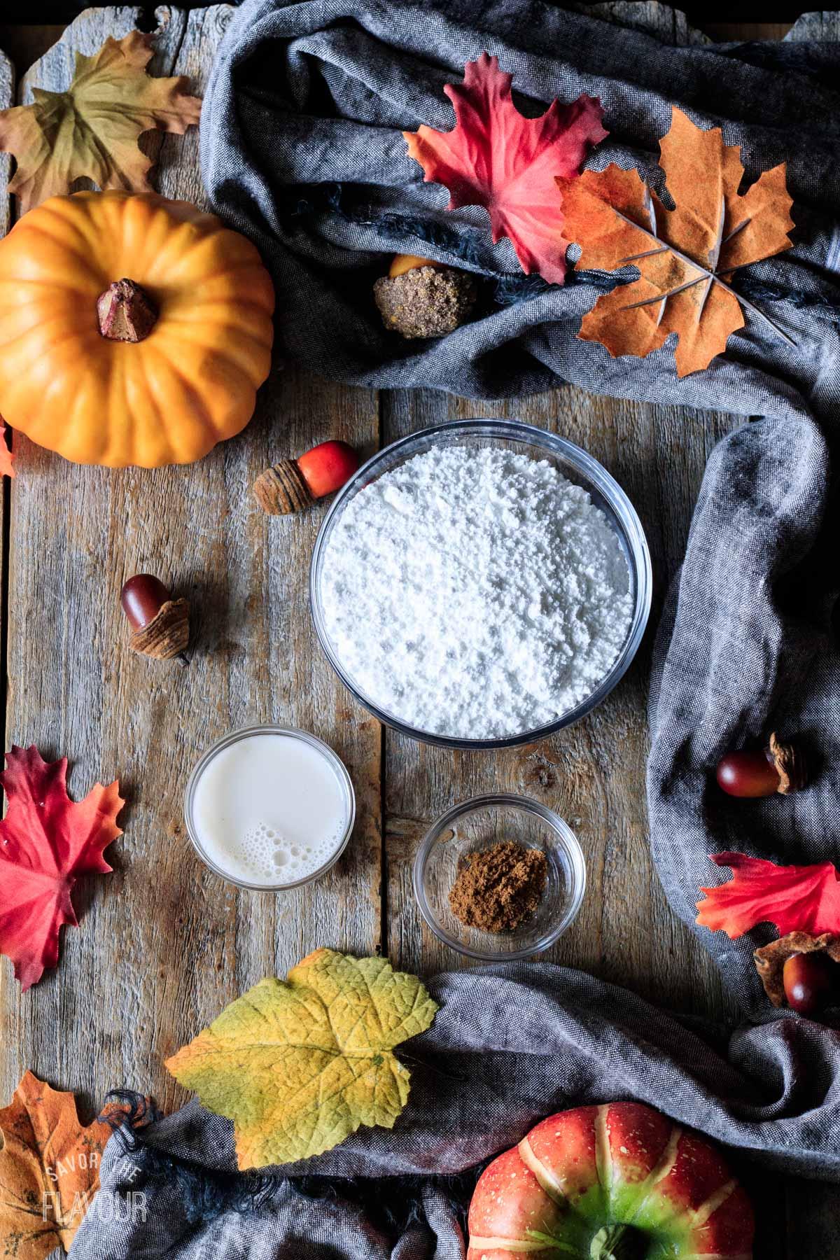 bowls of powdered sugar, pumpkin spice, and almond milk