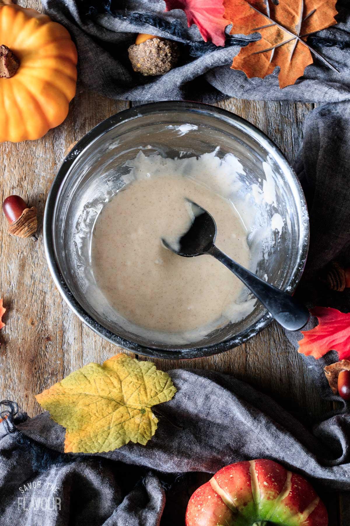 bowl of pumpkin spice glaze for scones