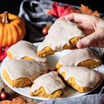 person holding a vegan pumpkin scone