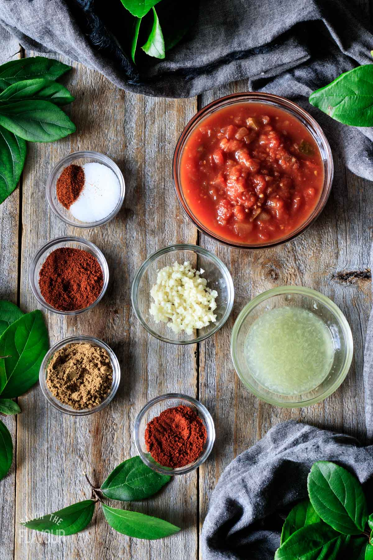 bowls of spices and flavorings for the quinoa taco meat