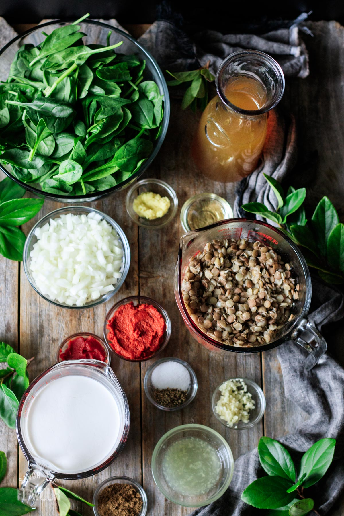 bowls of ingredients for green lentil curry