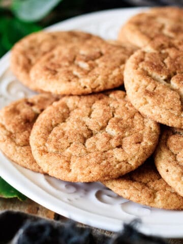 stack of vegan snickerdoodles on a white plate