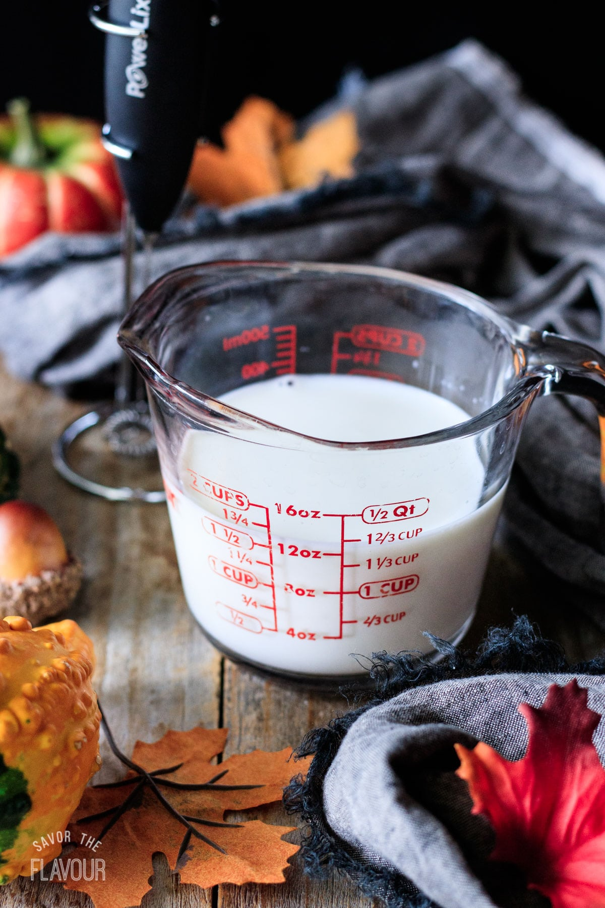 glass measuring cup filled with milk
