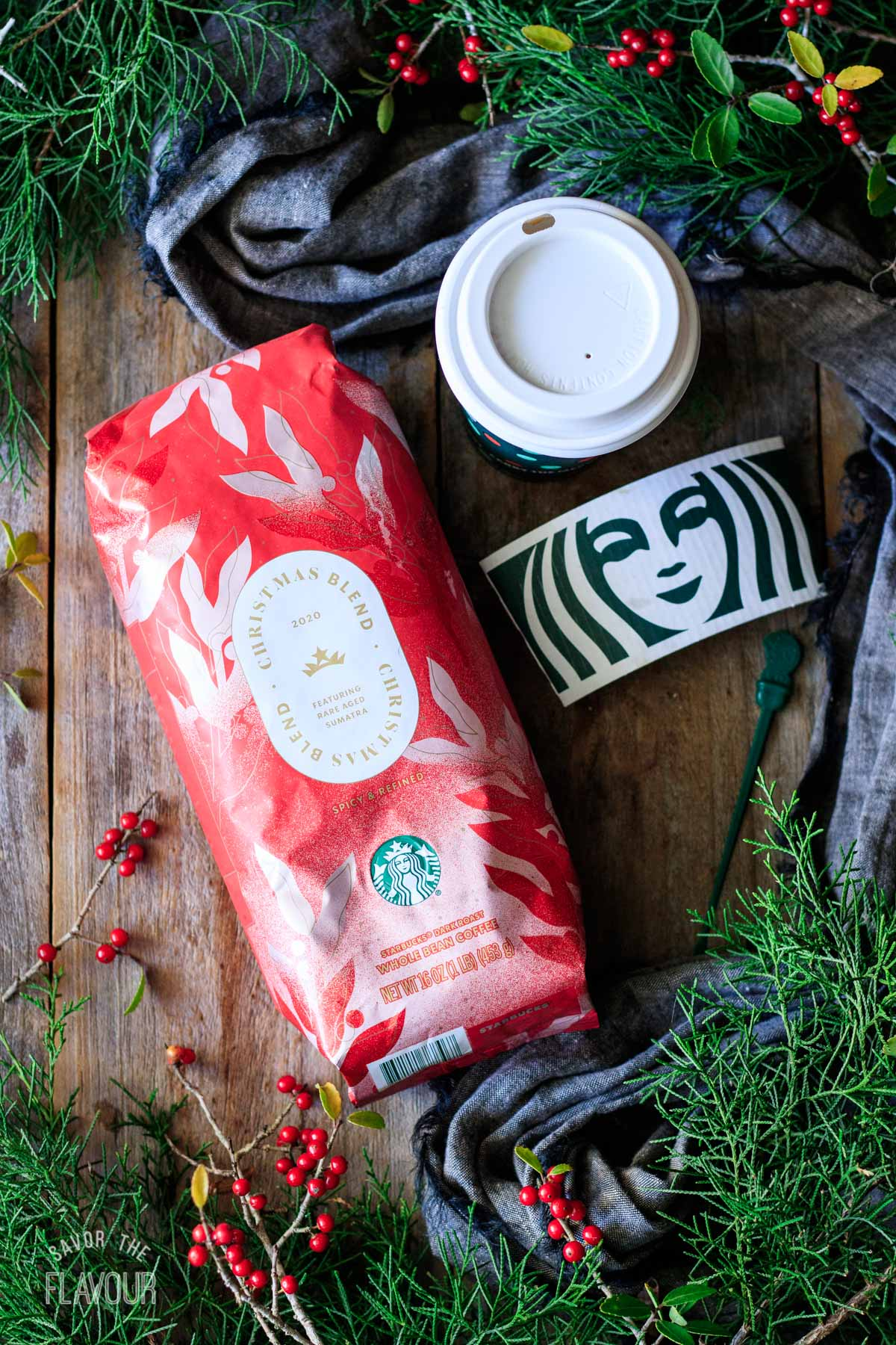 bag of Christmas blend coffee beans with a Starbucks drink