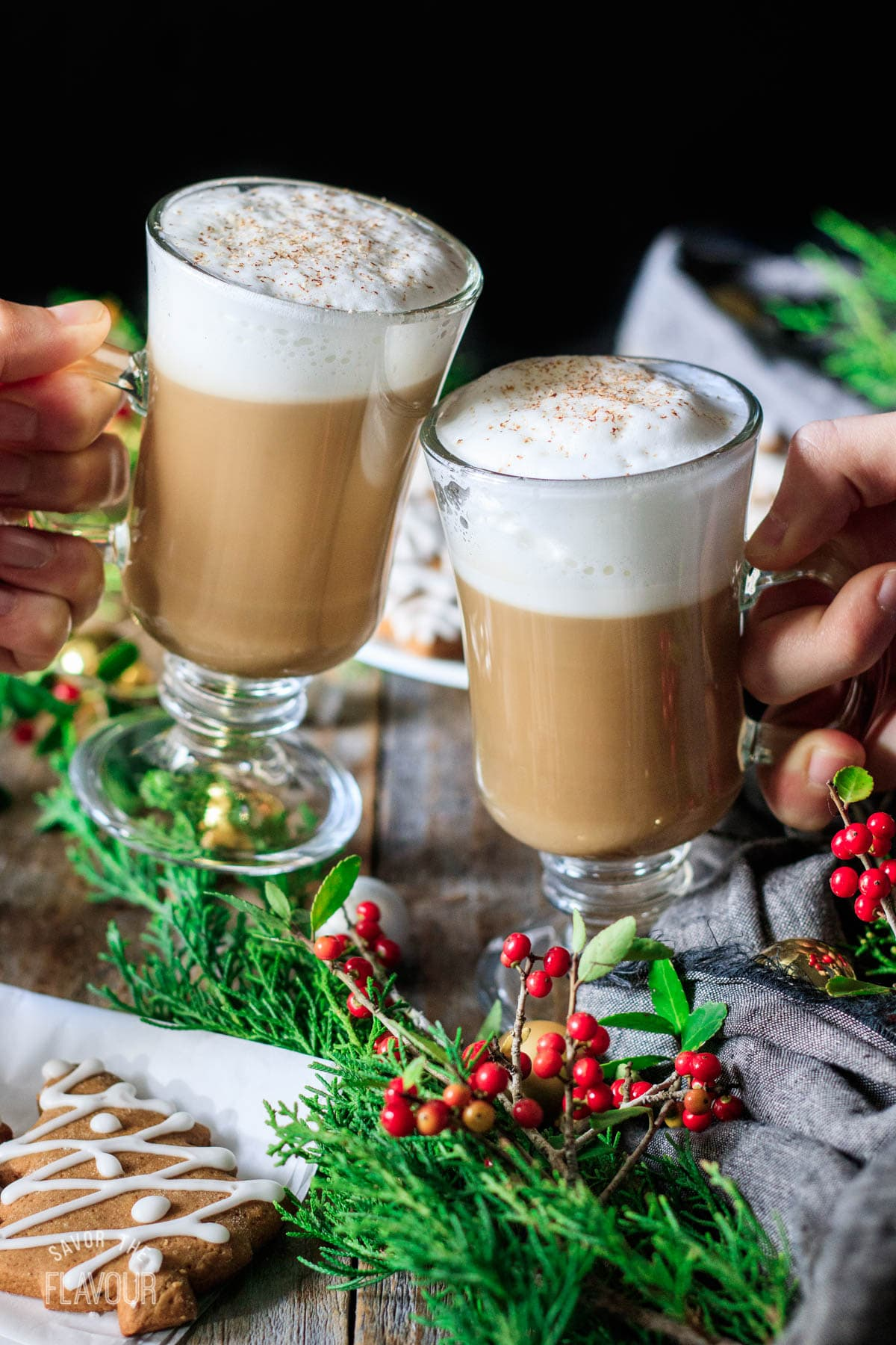 people doing a toast with two Starbucks gingerbread lattes