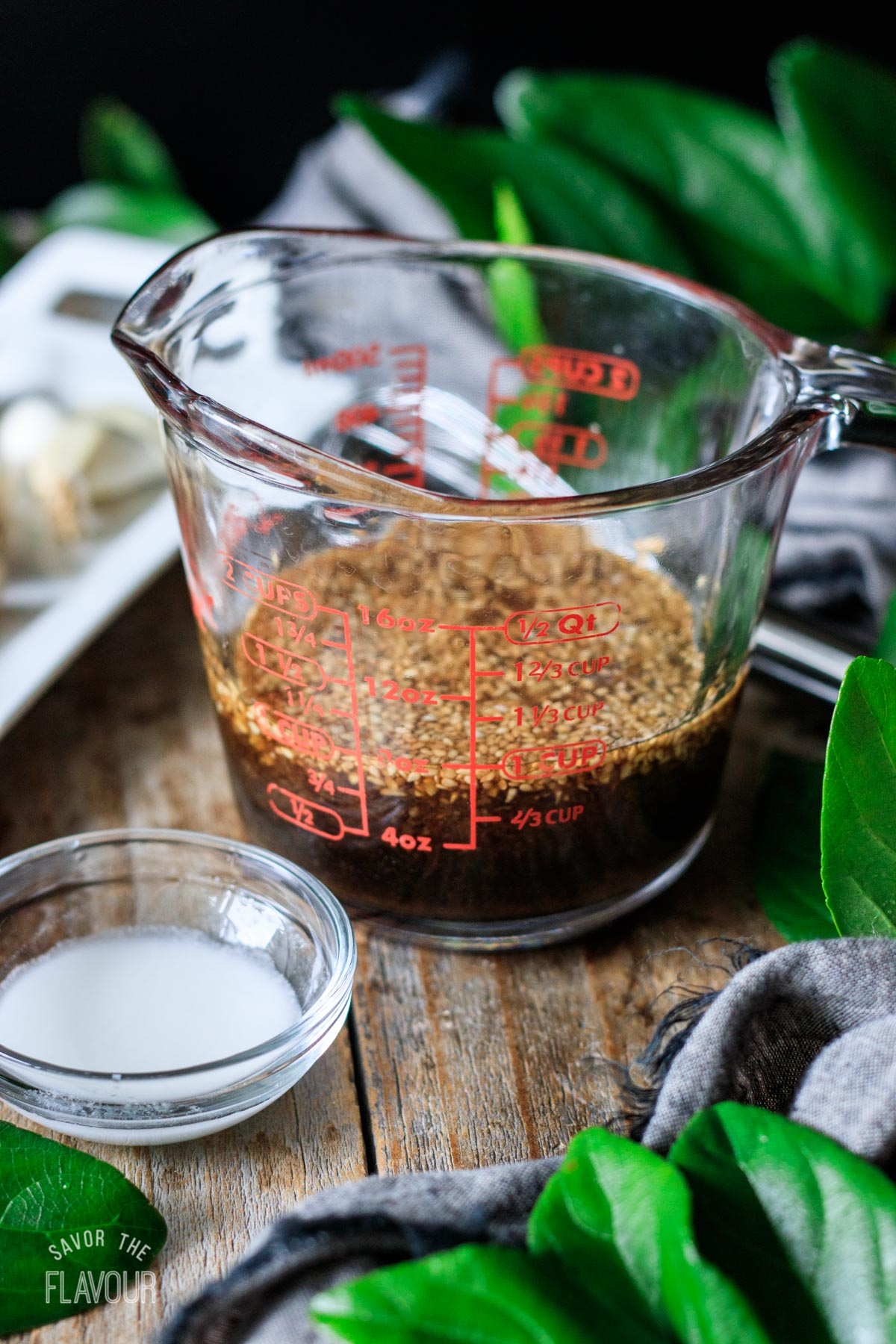 glass measuring cup filled with vegan stir fry sauce