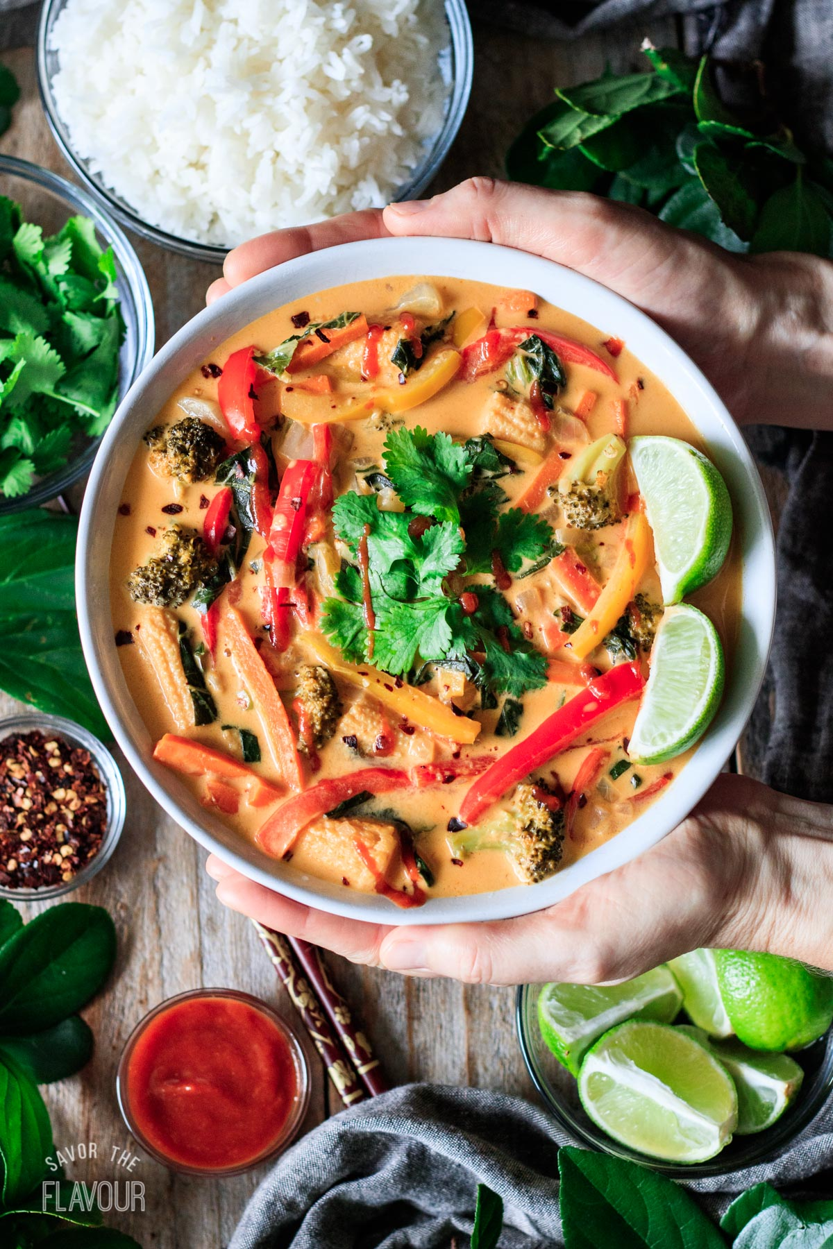 person holding a bowl of Thai red curry