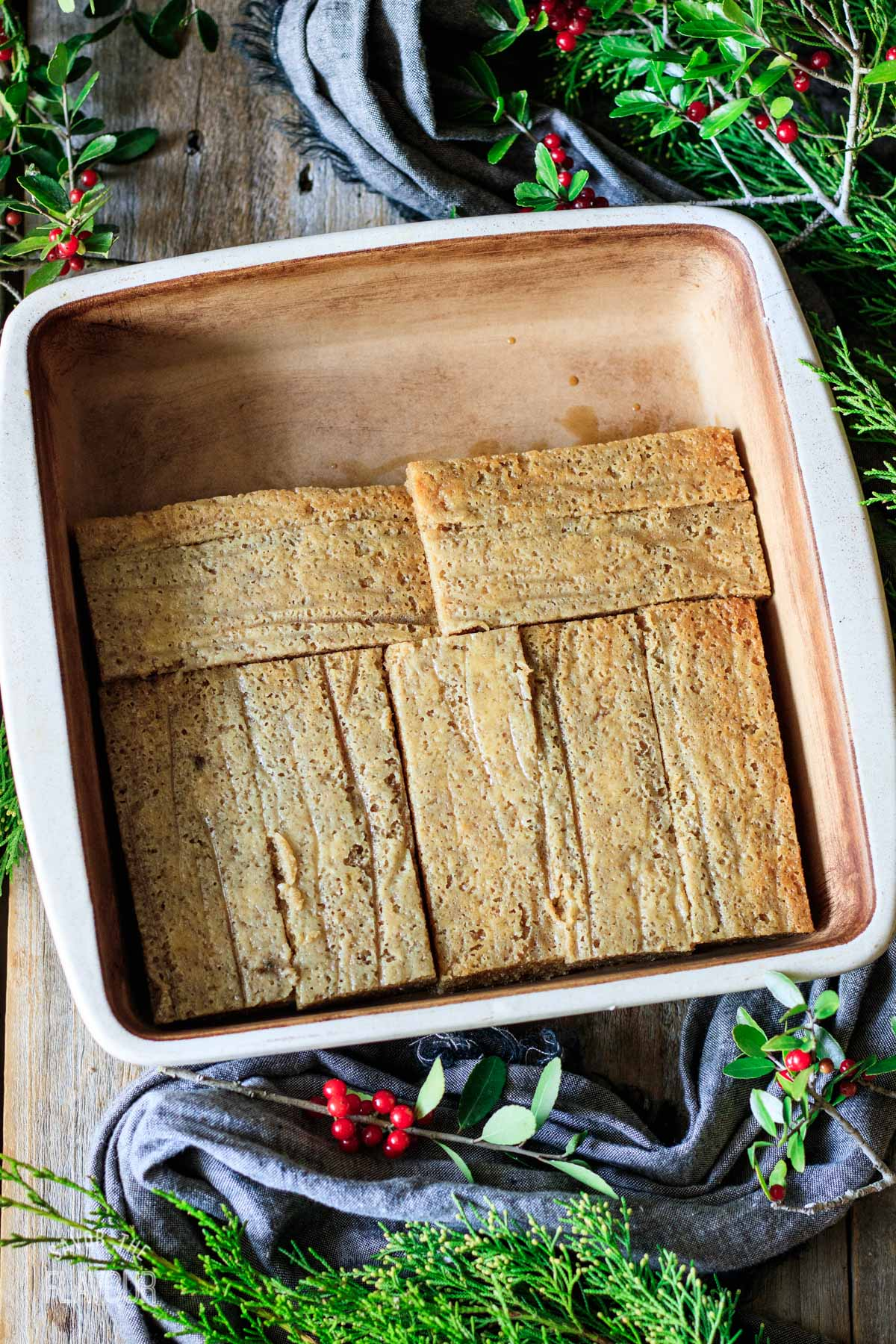 espresso soaked cake strips in a square pan